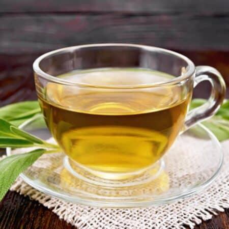 green tea sin a glass teacup